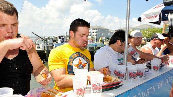 Competitors participate in Fish Tales' annual hot dog eating contest. Winner Jamie McDonald, center, of Hartford, Connecticut, ate 36 dogs to win the $1,000 first prize in 2013.