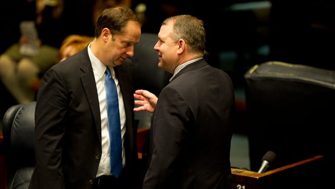 Florida Sen. Joe Negron, R-Stuart, speaks with Sen. Rob Bradley, R-Fleming Island, during a Florida Senate session on Jan. 13, 2016, at the Florida Senate in Tallahassee.