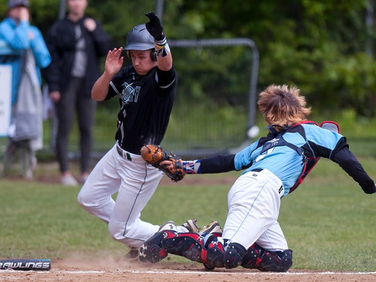 South Burlington catcher Seamus McGrath, right, tags out St. Johnsbury's Shawn Guckin in the second inning in the Division I high school baseball semifinals on Friday at South Burlington.