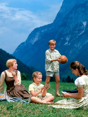 """Julie Andrews (from left), as Maria, Kym Karath, as Gretl, Duane Chase, as Kurt, and Charmian Carr, as Liesl, in a scene during the song, 'Do-Re-Mi' in the """"The Sound of Music."""" The classic musical is playing at Marcus Theatres on three days in May."""