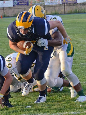 Ryan McRobb breaks this tackle to score Hartland's first touchdown of the season in Thursday night's win.