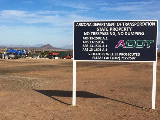 A sign was erected by the Arizona Department of Transportation in December warning a homeless camp near Mesa that it was trespassing on state property.