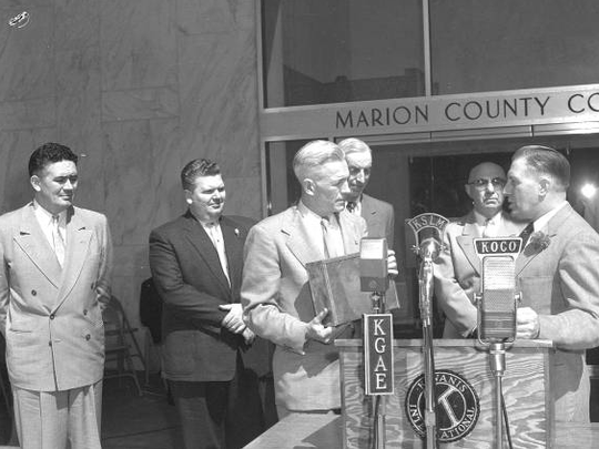 Marion County Judge Rex Hartley is shown in front of the microphones on June 18, 1954, during the dedication of the Marion County Courthouse.