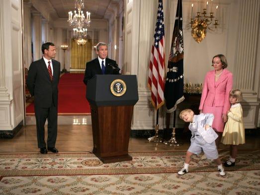 Then-president George W. Bush introduces John Roberts,