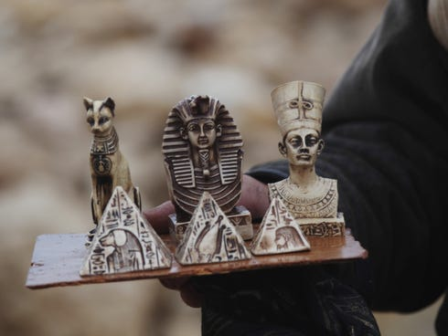 A man sells souvenirs at the historical site of the Giza Pyramids near Cairo, Egypt, on Dec. 13, 2013.