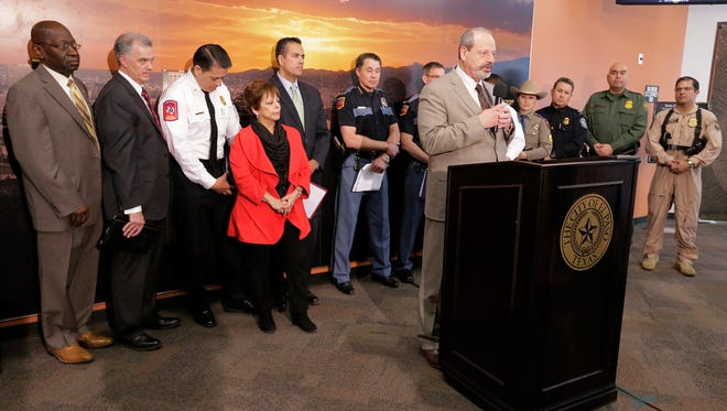 El Paso Mayor Oscar Leeser stands with several members of various law enforcement agencies and other city department heads Tuesday as he unveils the city's plan for street closures needed for security during Pope Francis' Feb. 17 visit to Juárez.