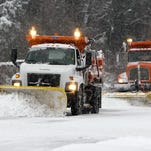 Snow plows work on clearing Newburg Rd near I-264. March 5, 2015