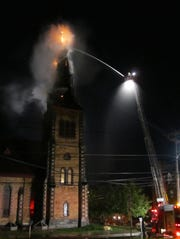 Fire breaks through the top of the steeple at the College
