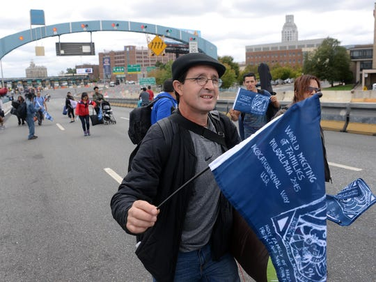 Pilgrims walk across the Ben Franklin Bridge in Camden on their way to the World Meeting of Families with Pope Francis in Philadelphia on Saturday.