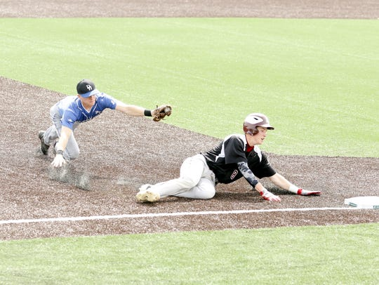 Nate Buley of Fort Plain slides safely into third base