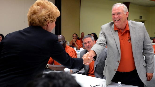 In this LSJ file photo, Michigan State Employer Marie Waalkes, left, shakes hands with UAW President Dennis Williams on Friday, July 24, 2015, to signal the start to contract negotiations.