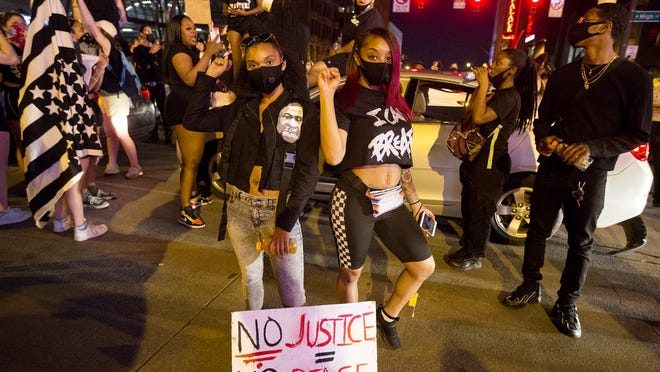 Protesters gather at High and Broad St. just before curfew, on the ninth day of protests for the Black Lives Matter movement, Friday, June 5, 2020.
