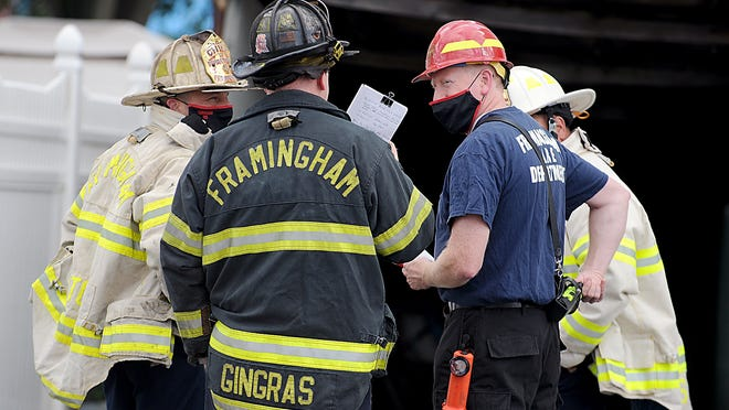 Framingham firefighters responded to a garage and porch fire at 33 East St. Wednesday afternoon.