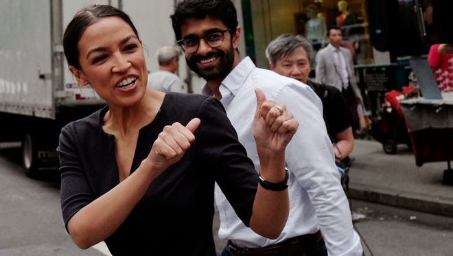 Alexandria Ocasio-Cortez, the winner of a Democratic Congressional primary in New York, greets a passerby in New York, June 27, 2018, the morning after she upset U.S. Rep. Joe Crowley in Tuesday's primary election.