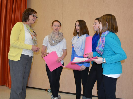 Karen Treml, who was named the new superintendent of Kewaunee public schools this week, talks with sixth-grade students preparing for their first forensics meet. From left are Elizabeth Rohr, Kaaryn Smidel, Ashley Hershfield and Chelsea Dax.