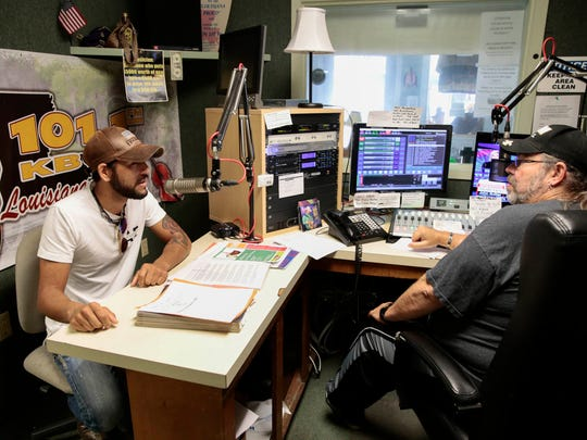 Musician Ethan Way, left, talks with DJ Hoss Childress at KBON studios in Eunice May 31, 2017.