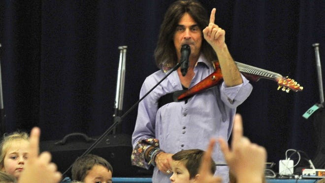 Original Trans-Siberian Orchestra member Mark Wood encouraged Fowler Elementary School students to sing along Tuesday afternoon as he performed on the electric violin. Wood travels to several schools annually with his music education program.