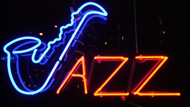 Johnny Bolan charms crowd with American standards, jazz- -- -Text: 11/16/00--A neon sign outside Heidi's Jazz Club in Cocoa Beach lets passerbys know what's played inside. Jazz pianist Johnny Bolan has been playing at the club for many years. PHOTO BY CRAIG BAILEY