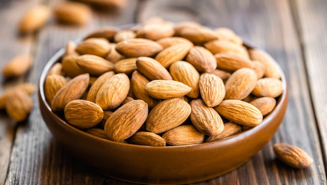 One cup of almonds has 378 mg of calcium and a cup of Silk almond milk has a whopping 450 mg.
