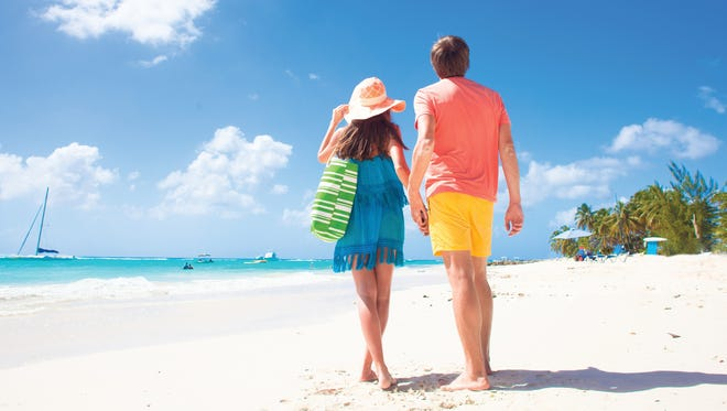 Honeymooning couples should make sure their beach bags are filled with the essentials for a day of soaking up the sun.