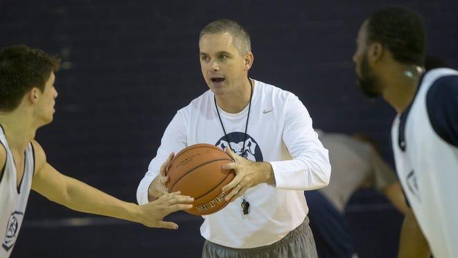 Chris Holtmann, interim Head Coach of the Butler Men's Basketball team, works his team through practice, Indianapolis, Sunday, October 12, 2014.