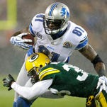 Green Bay Packers cornerback Tramon Williams tackles Detroit Lions receiver Calvin Johnson during their 2012 game at Lambeau Field.