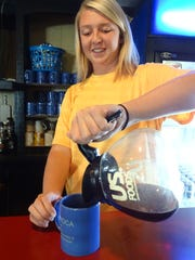 Alexis Creel, a server at the Bucyrus Diner, pours