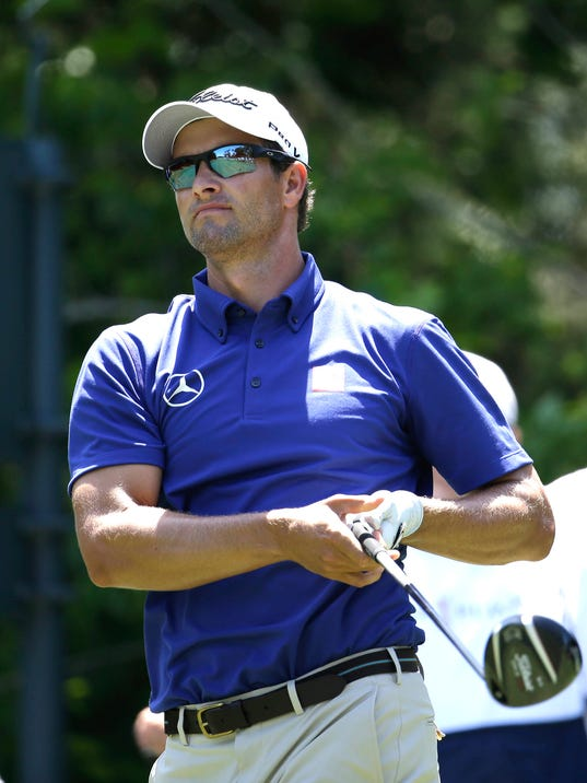 Adam Scott of Australia hits from the fifth tee during the first round of The Players championship golf tournament at TPC Sawgrass, Thursday, May 8, 2014 in Ponte Vedra Beach, Fla. (AP Photo/Lynne Sladky)
