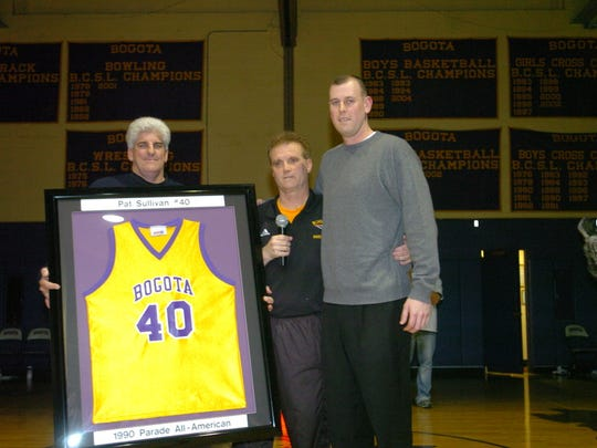 Pat Sullivan's jersey is retired in February 2006. His high school coach, Jay Mahoney, is in the center.