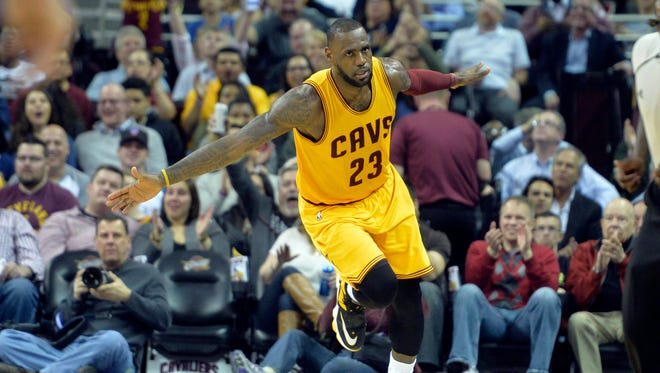 Cleveland Cavaliers forward LeBron James (23) reacts after a dunk in the second quarter against the Brooklyn Nets.