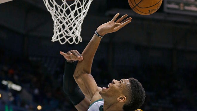 Milwaukee Bucks' Giannis Antetokounmpo (34) is fouled by Los Angeles Lakers' Julius Randle during the second half of an NBA basketball game Friday, Feb. 10, 2017, in Milwaukee.