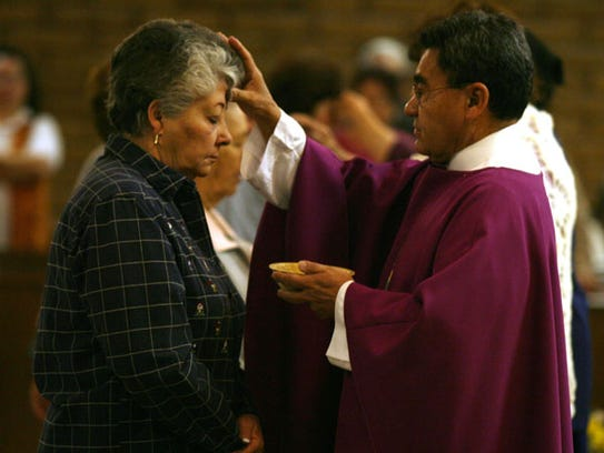 The Rev. Raul Trigueros of Christ the King Catholic