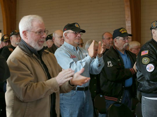 Veterans rise and applaud for Dr. Peter  Ziarnowski,