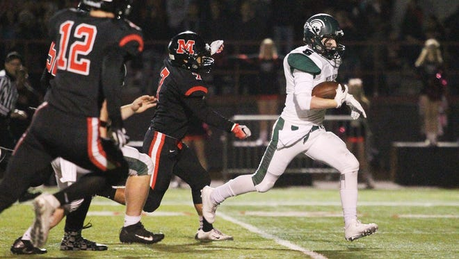 West Salem running back Jacob Denning cuts through the defense against McMinnville on Thursday.