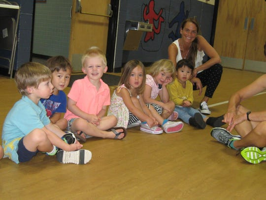 The first formal physical education class for these 3-year-olds at Mater Christi School in Burlington These little ones represent the towns of Milton, South Burlington, Shelburne, Winooski and Burlington. Shown also are their classroom teacher, Beth Gazo and their physical education instructor, Donna Quinlan.