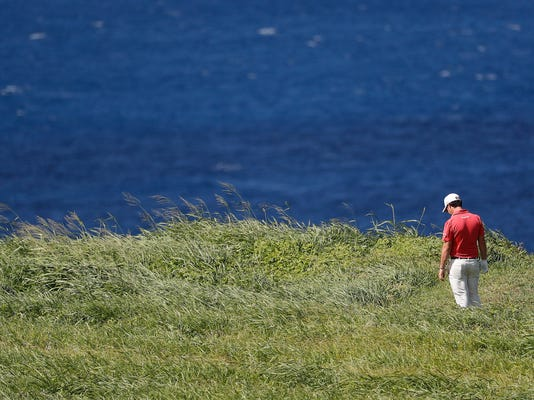 Brian Harman looks for his golf ball in the 12th fairway rough during the third round of the Tournament of Champions golf event, Saturday, Jan. 6, 2018, at Kapalua Plantation Course in Kapalua, Hawaii. (AP Photo/Matt York)