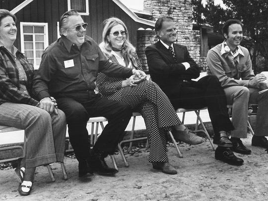 The Rev. Billy Graham, second from right, is seated near Grady Wilson on Nov. 24, 1974, when Wilson was honored at West Texas Ranch for Christ, near Blackwell.