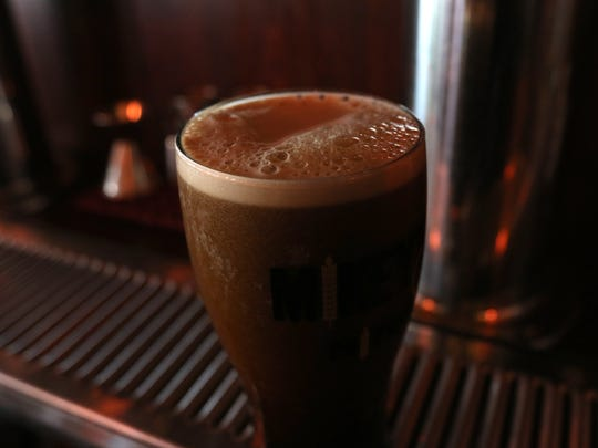 A nitrogen-brewed Left Hand Milk Stout inside Mikey's Bar and Grill, September 14, 2016.