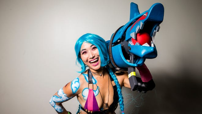 Deb Ehrman, of Independence, as Jinx from League of Legends poses for a portrait at the Cincinnati Comic Expo at Duke Energy Convention Center Saturday, September 24, 2016.