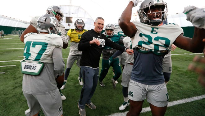 Eastern Michigan football coach Chris Creighton reacts with players during a drill in Ypsilanti, Mich., Monday, Dec. 10, 2018. Eastern Michigan's football team has stepped out of the shadows created by the neighboring University of Michigan and four professional teams just down the road in the Motor City. The Eagles will face Georgia Southern in the Camellia Bowl on Saturday, earning a spot in NCAA football postseason play for the second time in three years and just the third time in school history. (AP Photo/Paul Sancya)