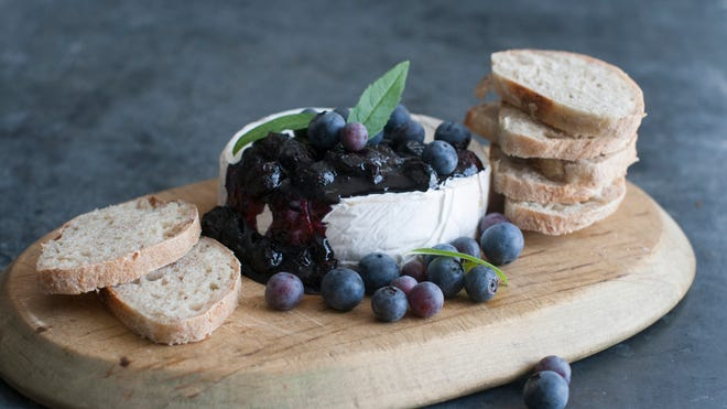 Fresh blueberries can be cooked down for a savory topping served over brie.
