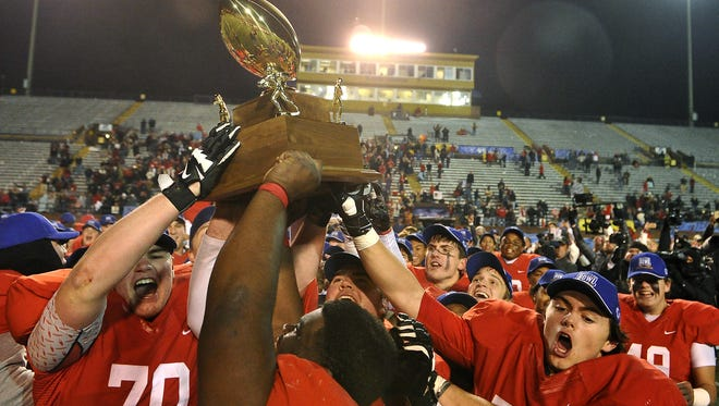 Brentwood Academy hoists the DII-AA state championship trophy last season.