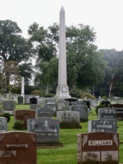 The obelisk-shaped memorial surrounded by graves of