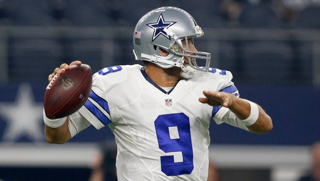 Dallas Cowboys quarterback Tony Romo (9) throws a pass in the first quarter against the Miami Dolphins in a preseason game at AT&T Stadium.