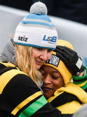 epa06420607 Jamaica's Audra Segree (L) hugs Jamaica coach Sandra Kiriasis from Germany after the second run of the Women's race at the Bobsleigh World Cup in Altenberg, Germany, 06 January 2018.  EPA-EFE/FILIP SINGER ORG XMIT: _FIS9015
