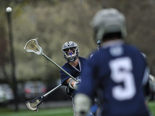 Tommy Shaughnessey of Manasquan, passes the ball to