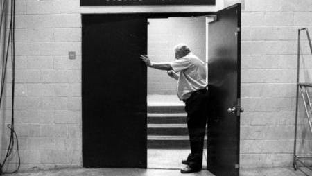 A photo of coach Don Haskins at the locker room door before one of the Miners 1991-92 season home games.