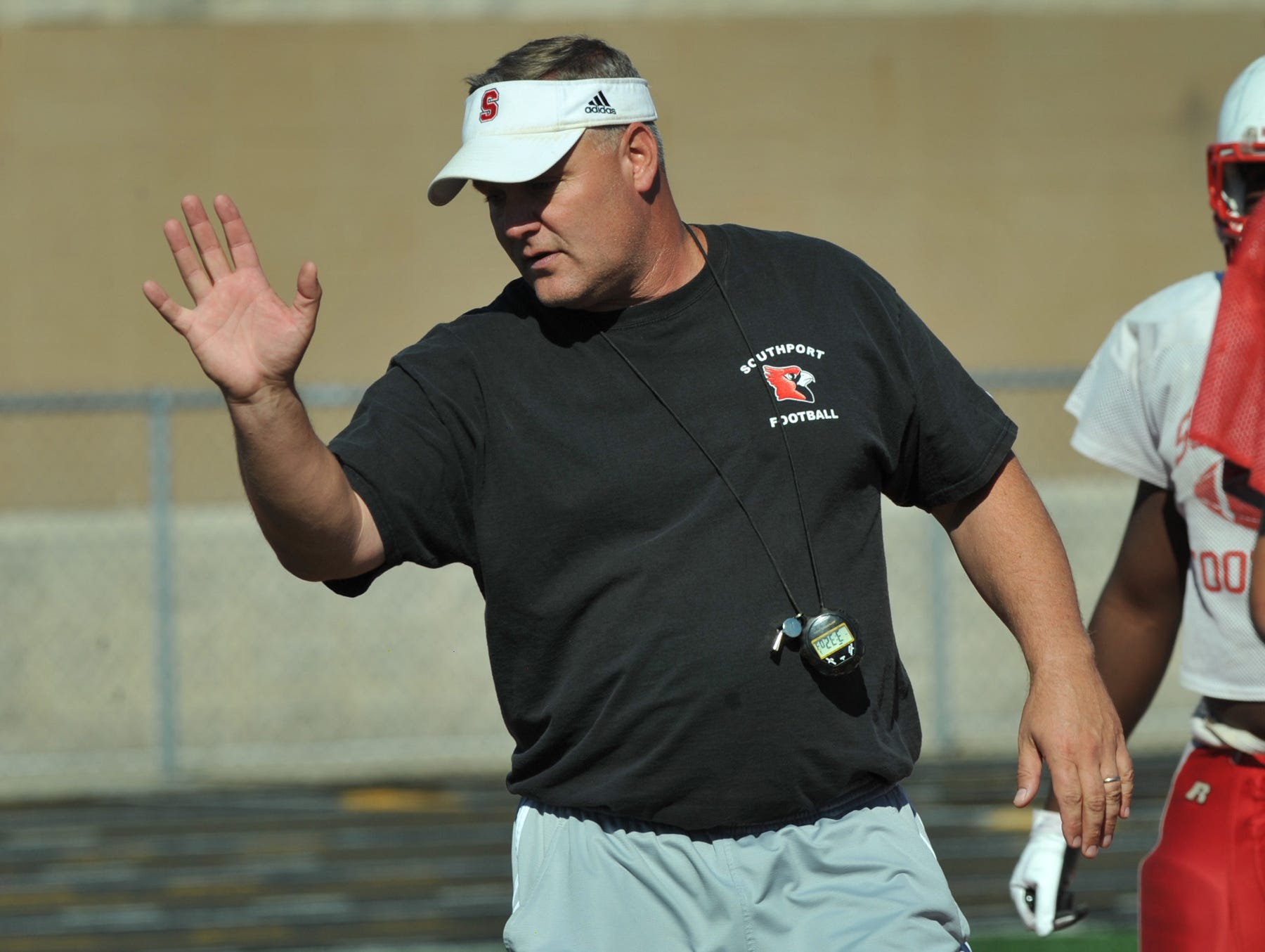 Southport football coach Bill Peebles instructs players during practice Oct. 8, 2013.