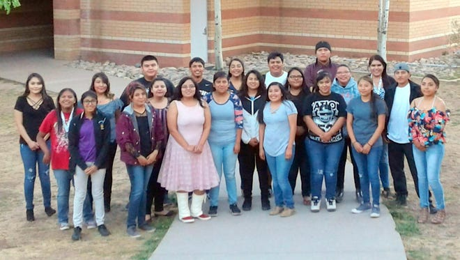 The seniors at Mescalero High School who received scholarships and were recognized at the awards night pose outside the school.