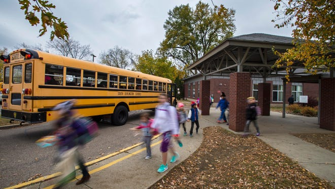 Students board buses at the end of the day at Rick Marcotte Central School in South Burlington on Thursday, Oct. 27, 2016.
